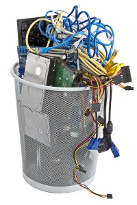 Photo of trash can full of e-waste.