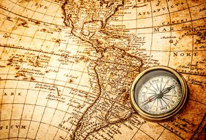 Photograph of vintage map and compass.