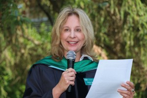 Kara McFall, UO AIM Program director, speaks at commencement.