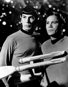 Leonard Nimoy and William Shatner post as Spock and Captain Kirk in a vintage black and white photo from the Star Trek series.