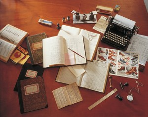 Vintage photo of books, journals, pens, and other tools of research circa 1930.