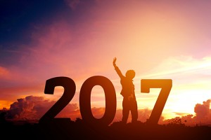 Image of exuberant person with raised arm forming the 1 in 2017.