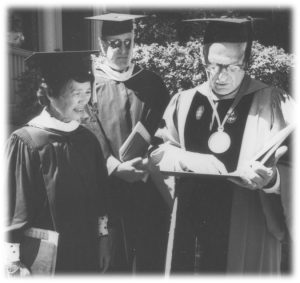 Michi Yasui Ando receiving her UO degree in English at the 1986 graduation ceremony, 44 years late.