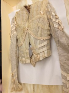 Bodice of the dress. Acid-free paper was also placed in the arms and chest for support and to prevent further creasing.