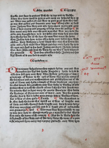 Printed leaf in Gothic face with initials and paragraphs added by hand in red ink.