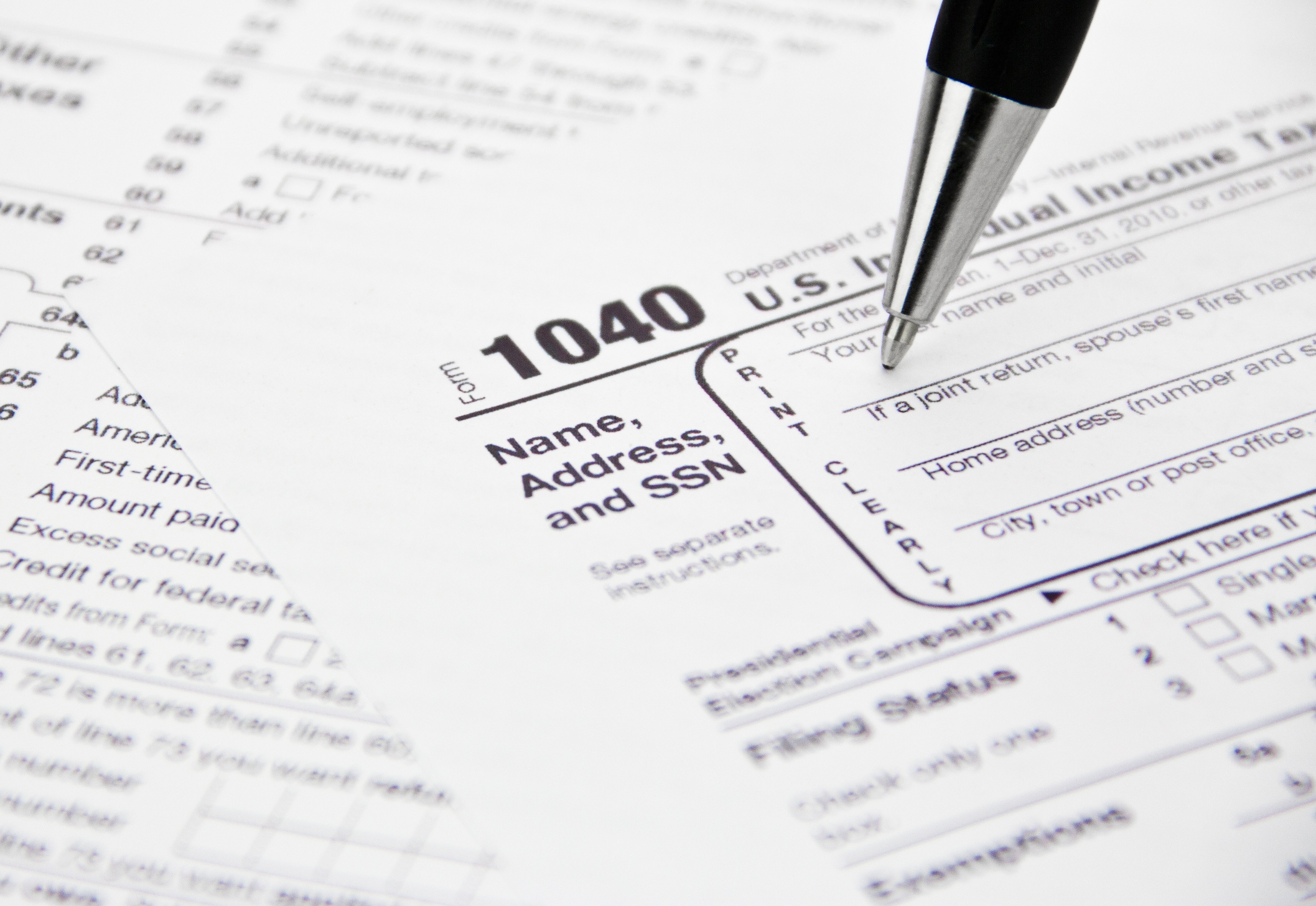 Non resident tax information irs 1040 tax form being filled out falaconquin
