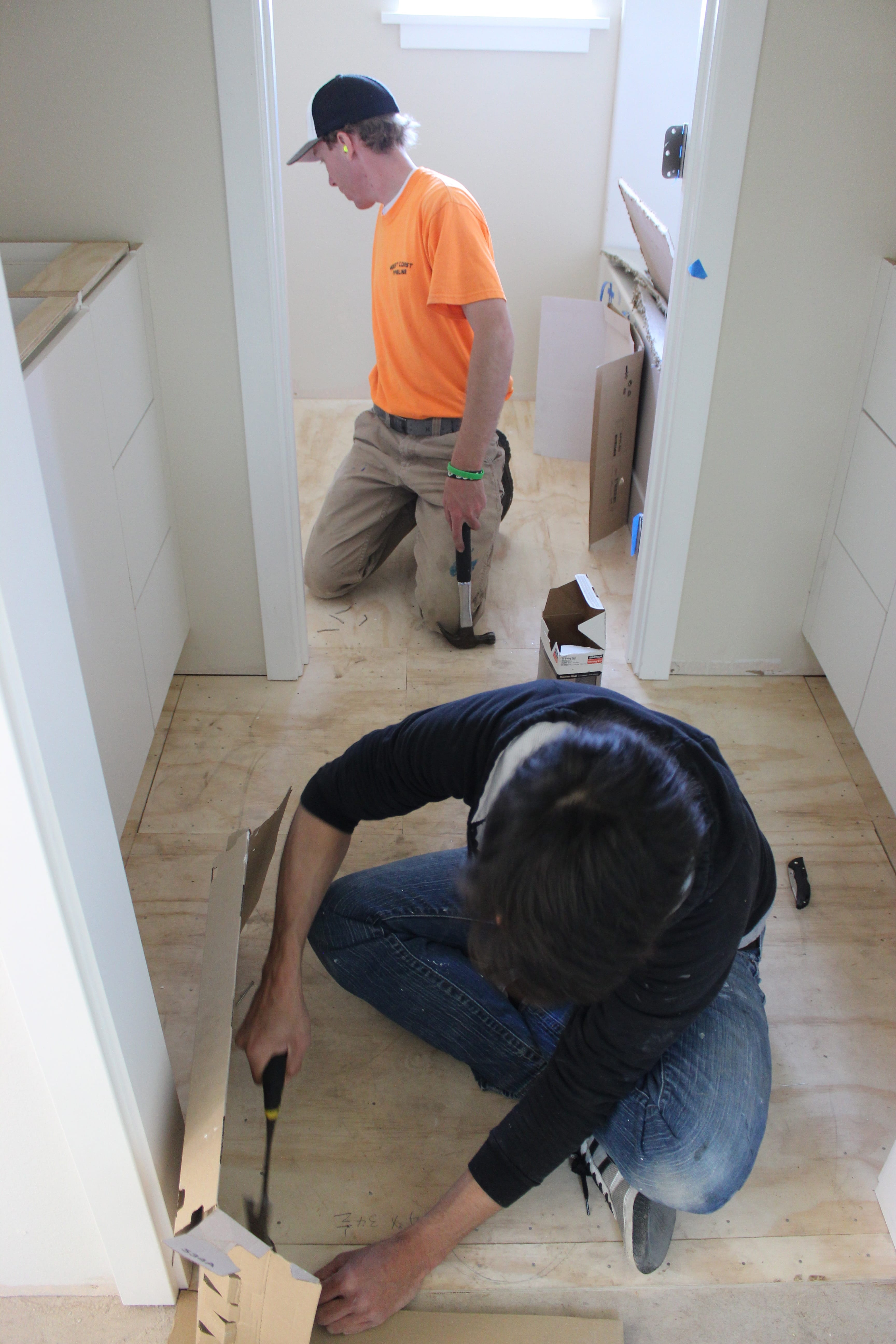 Nailing the plywood in the bathroom