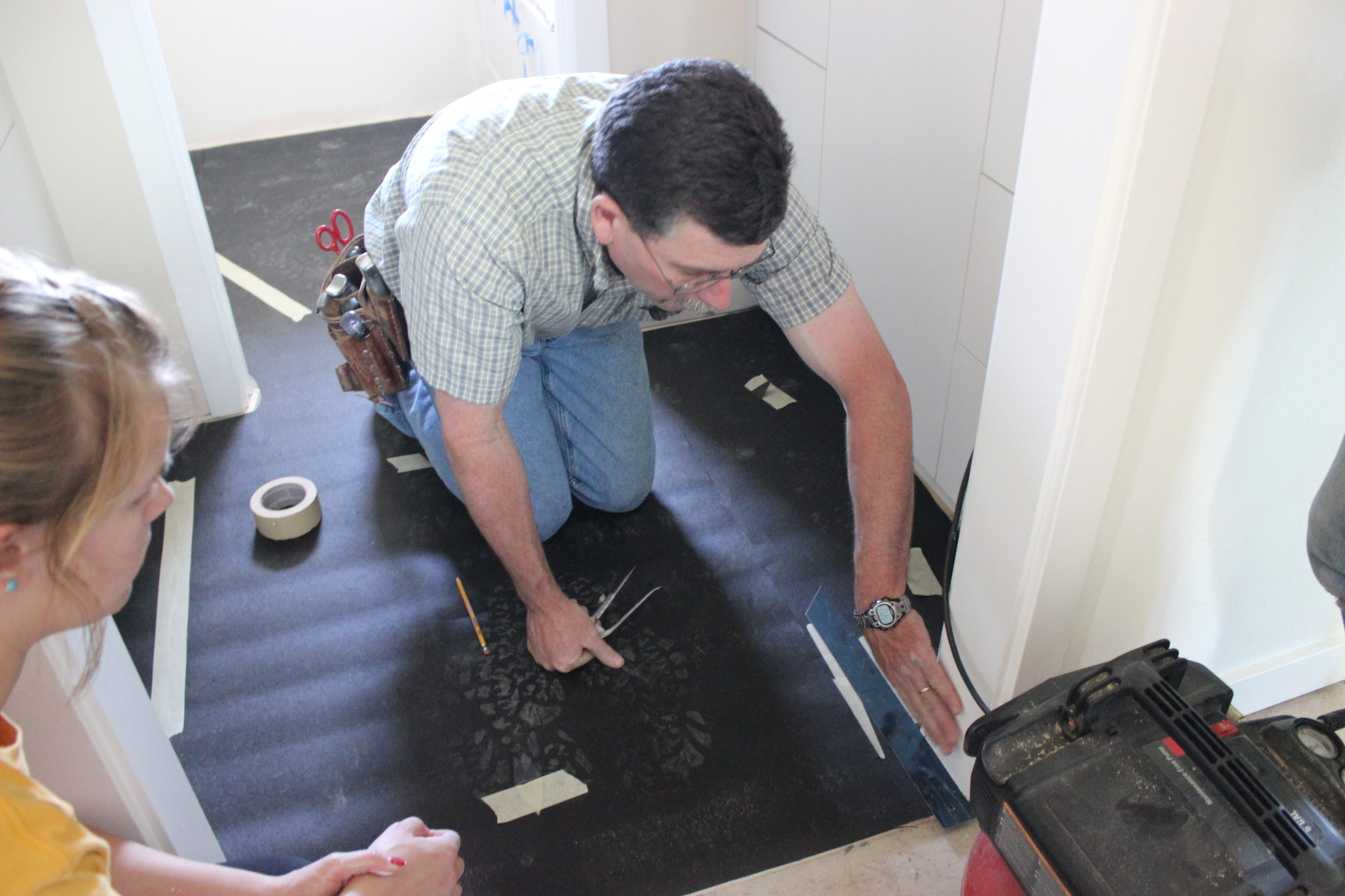 A specialist teaching us how to install linoleum