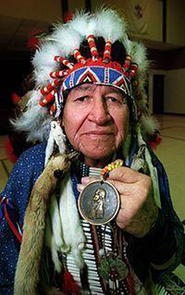 Indian artist Paha Ska, of Keystone, S.D., an Elder of the Oglala Sioux tribe from the Pine Ridge Reservation in South Dakota, holds an authentic Presidential Peace & Friendship Medallion from President Thomas Jefferson, Monday, Dec. 17, 2001, during a visit at St. Mary School in Elyria, Ohio, that was given to Indian leaders by the Lewis and Clark Expedition in 1803. Paha Ska, who is about 80 years old, talked about and answered questions about Native Indians. (Photo/Paul M. Walsh)