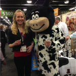 Karen tries some samples with a mooing mascot