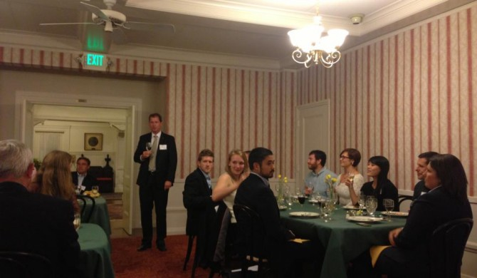John Hull addresses students and other guests at dinner
