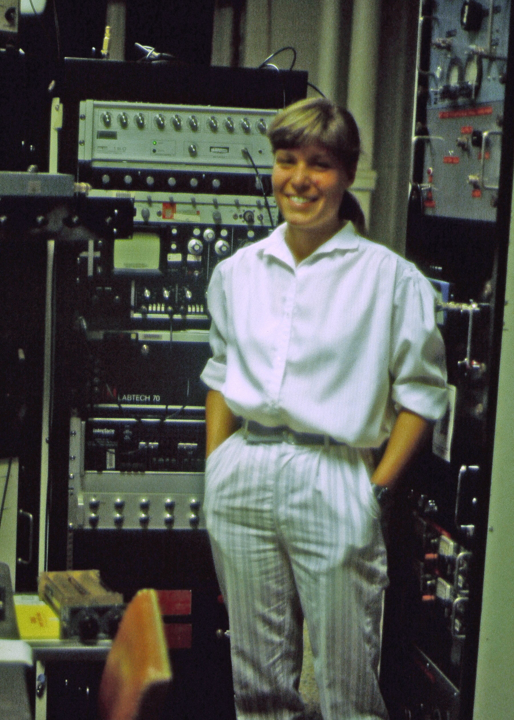 Faith Van Nice with NMR Spectrometer