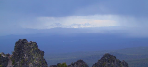 Views of the Cascades, the Tree Sisters volcanos, from the rim of the Newberry caldera looking west through thunder storms