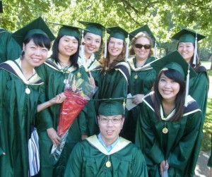 Marcella with some of her cohort at graduation in August 2010. She is the one in the middle top of the photo.