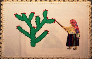 "An appliqué piece from San Francisco Tanivet, Oaxaca, showing a woman harvesting the ""tunas"" (fruits) of the nopal. (Photo, R. Haskett, 2014)"