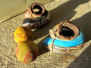 "Two rubber balls and two ""guantes"" (gloves or mitts) from Amilpas. (Photo, S. Wood, Nov. 2013)"