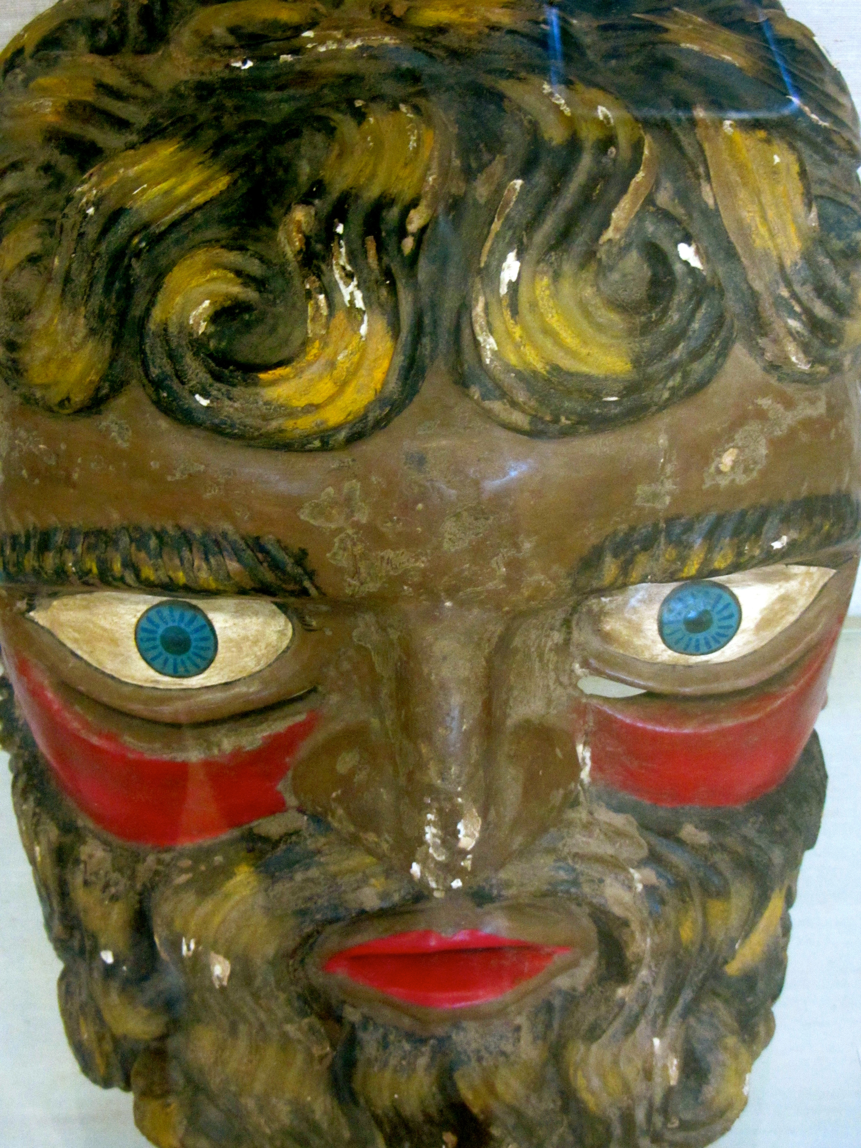 """Indigenous community dance mask representation of a """"Spaniard."""" (S. Wood, photo of an exhibit in the Benson Library, UT Austin, 5/30/2014)"""