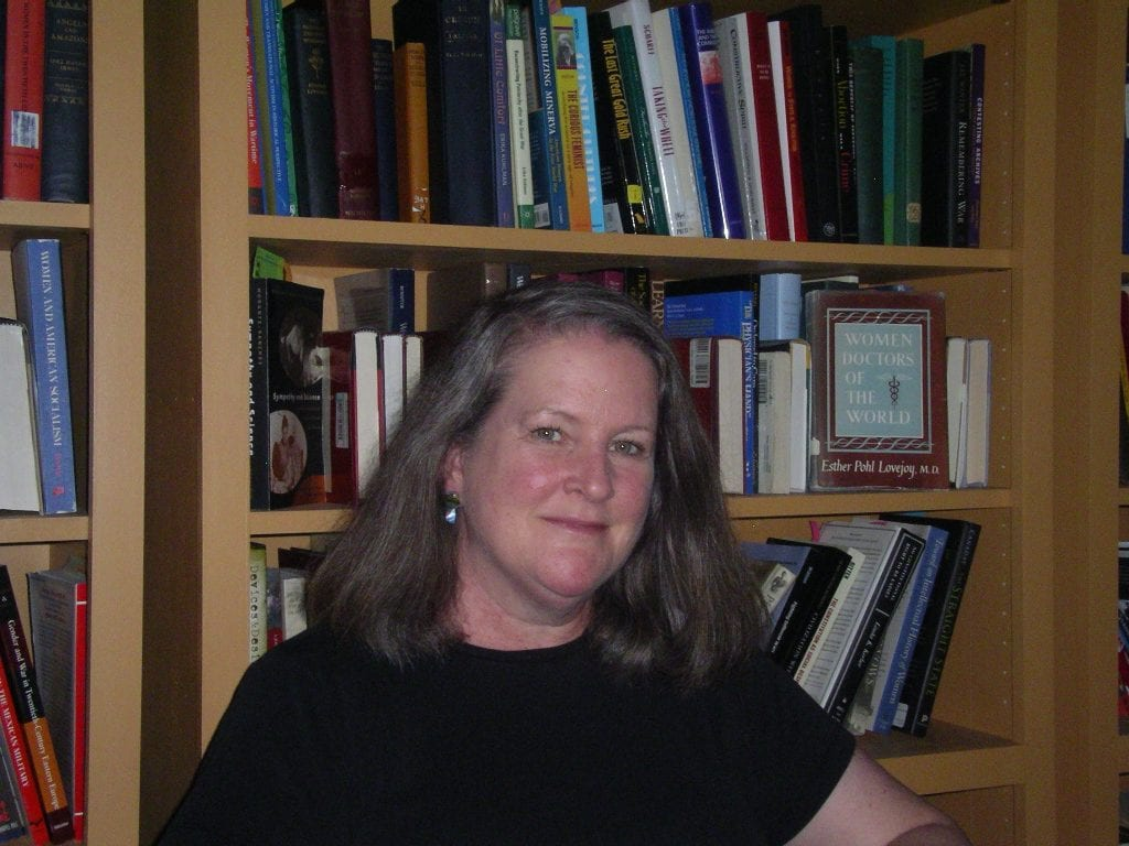 Kimberly Jensen in front of a bookcase