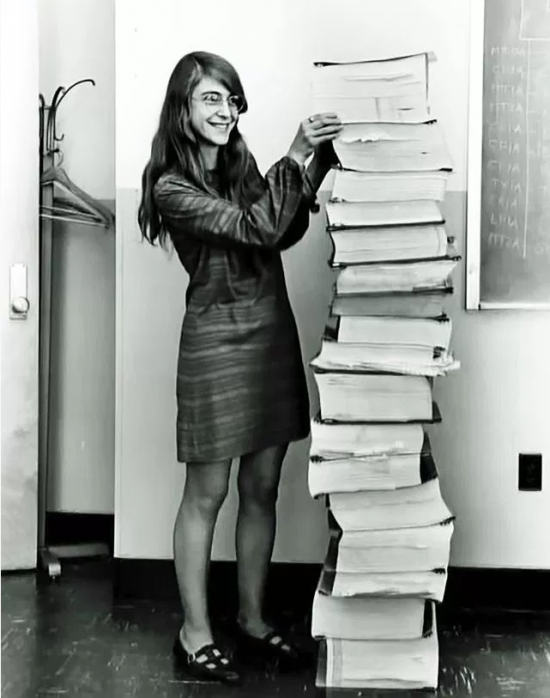 Margaret Hamilton, director of software engineering on Apollo 11, next to the printout of the code.
