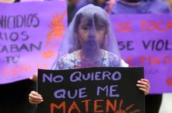 A girl participating in an International Women's Day protest in Mexico City in 2017 holds up a poster reading 'No quiero que me maten.' ('I don't want to be killed.')