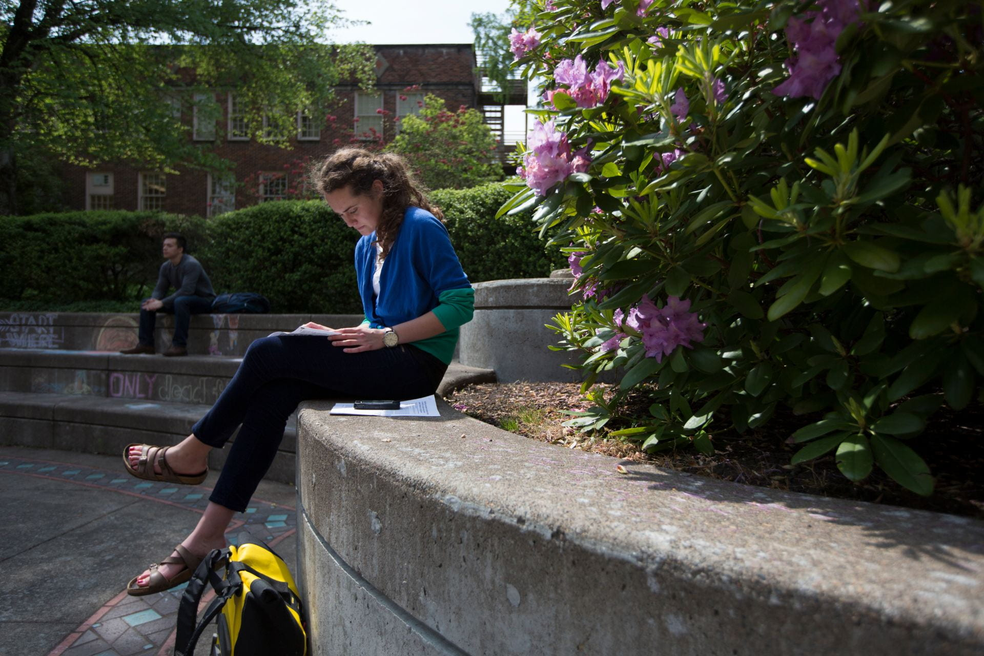 girl studying with rhodedendrons