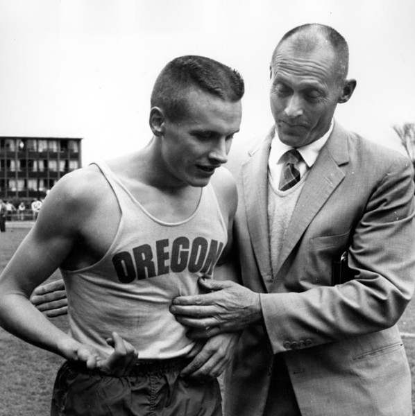 Black and white photograph of University of Oregon miler Dyrol Burleson and Coach Bill Bowerman in April, 1960, after Burleson finished the mile in 3:58:6, the first sub-four minute mile run at Hayward Field.