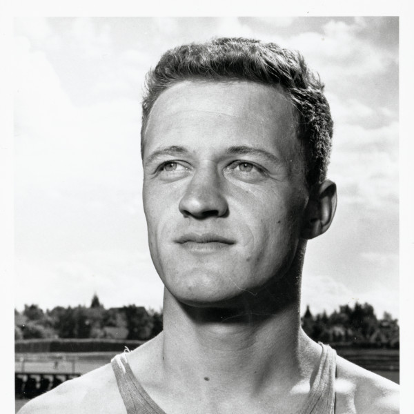 Black and white photo of University of Oregon runner and future U of O track coach Bill Dellinger, taken at hayward Field in 1964, the year in which he won a bronze medal in the 5,000 meters at the Tokyo Olympic Games.