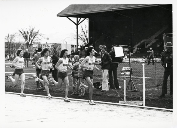 Black and white photo of four University of Oregon distance runners taken during a race at Hayward Field in the late 1970s. In front is Alberto Salazar, trailed by Rudy Chapa, Terry Williams and Don Clary.