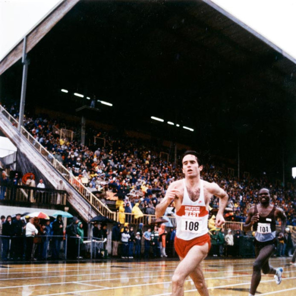 Color photo of former University of Oregon distance runner Alberto Salazar, running for Athletics West, ahead of former world record holder Henry Rono of Kenya during a race held at Hayward Field on April 8, 1982. Rono won the race, edging Salazar by 0.1 second.