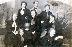 "Black and white photo of the 1894-95 University of Oregon sophomore women's basketball team. ""Class of '97"" appears on the front of the arm of the seat."