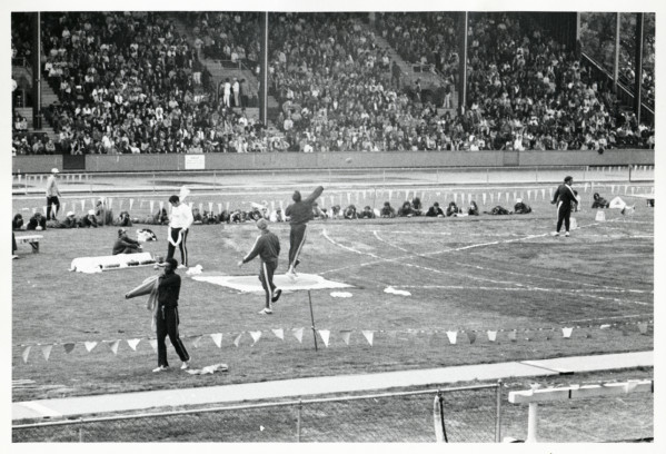 Black and white photo of Randy Matson warming up for the shot put competition at Hayward Field during the 1972 Olympic Trials, where his fourth place finish kept him from making the American team.