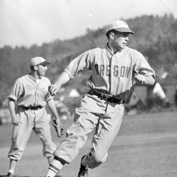 Black and white photo of University of Oregon outfielder Bill Carney rounding third base during a game against Idaho at Howe Field in either 1942 or 1943.