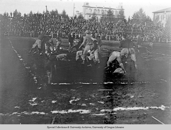 Black and white photo of action during a 1907 University of Oregon football game played at Kincaid Field.