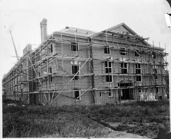 Black and white photo of the Women's Memorial Hall under construction in 1919. The building was completed in 1921 and renamed Gerlinger Hall in 1929.