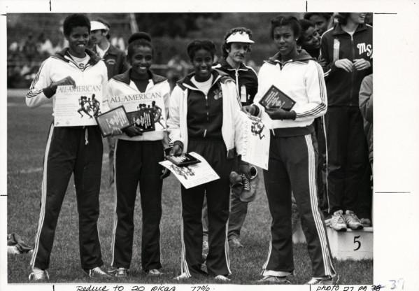 Black and white photo of the University of Oregon's 1979 All-American mile relay team. From left to right: Melanie Batiste, Dawna Rose, Rhonda Massey and Debbie Adams.