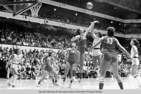 Black and white photo of an unidentified University of Oregon basketball player taking a jump shot against the Soviet Union's national team during a game played at McArthur Court on December 3, 1979. The Soviets defeated the Ducks 131-53 in the game.