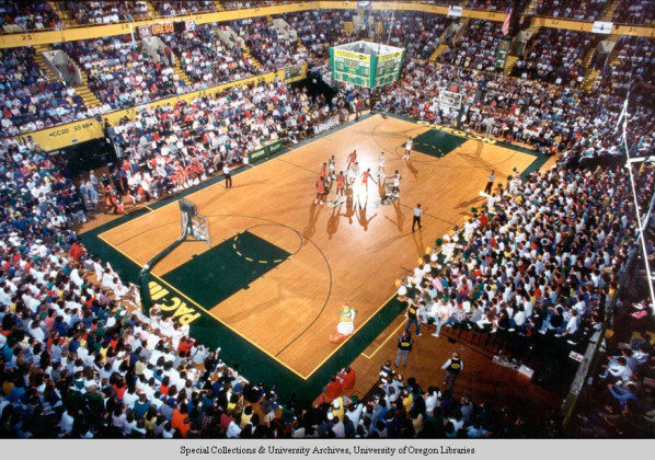 Color photo, taken from the 300 level of McArthur Court seating, of the floor as a game is about to get underway during the 1970s.