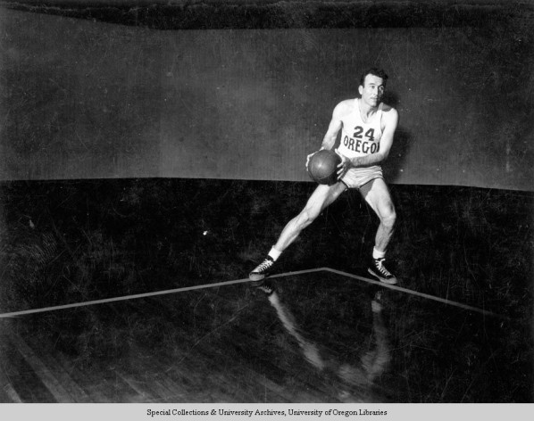 Black and white photo of University of Oregon basketball player Paul Cooper taken at McArthur Court in 1949.