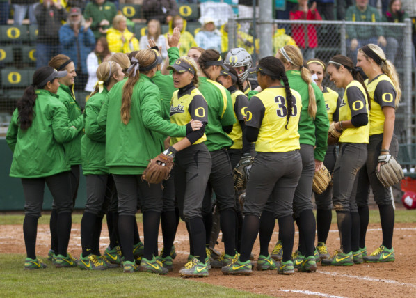 Color photo of the University of Oregon softball team celebrating a 3-0 victory over Wisconsin in an NCAA regional game on May 18, 2013 at Howe Field. With the win, the Ducks advanced to host a super regional series.