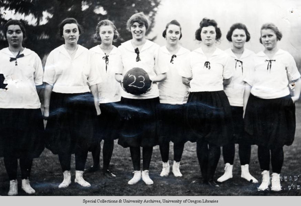 Black and white photo of the class of 1923 women's inter-class basketball team taken in 1920, their freshmen year. The freshmen team won the inter-class championship that year. Picture appears on page 219 of the 1920 Oregana.