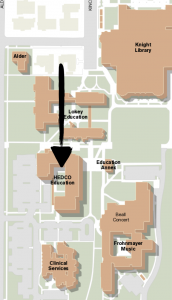 A map of the University of Oregon campus with a black arrow pointing to the HEDCO Education Complex.