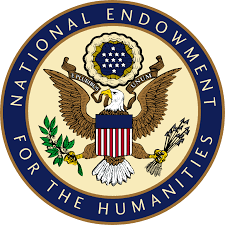 The crest of the National Endowment for the Humanities, which features an eagle with an American flag shield clutching an olive branch in one claw and a collection of arrows in the other.