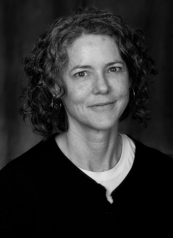 Elizabeth Peterson headshot, black and white, slightly smiling wearing a black sweater.