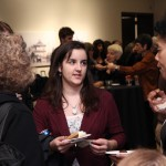 Eryn Cangi, assistant event coordinator, chats with Andrea Hairston and Professor Elizabeth Reis at the closing reception.
