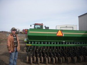 Paul Bates showing wheat farm equipment; photo courtesy of Nancy Nusz