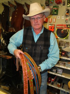 Ron Wilson with leatherwork; photo courtesy of Nancy Nusz