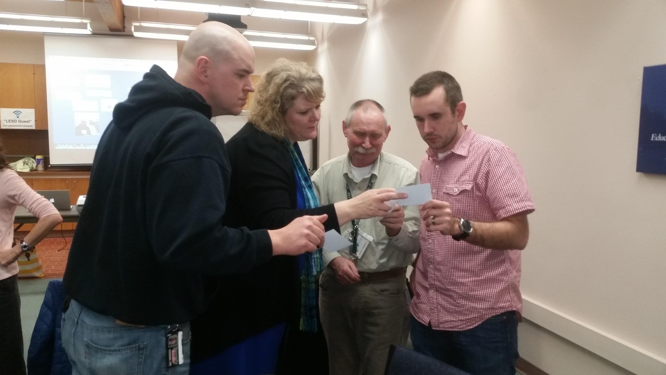 C2SL Workshop - Teachers compare math solutions resized