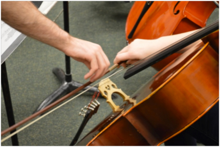 A student working on bowing technique