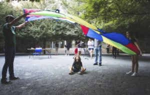 Figure 1. Children playing in Fleischner courtyard at DMA Autism Awareness Day