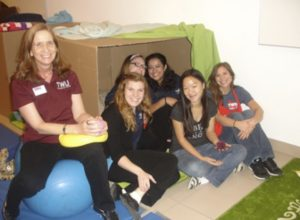 Figure 7. TWU professor, Dr. Tina Fletcher, with TWU occupational therapy students at the DMA.